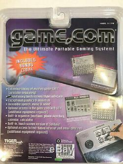 Tiger Game. Com NEW Handheld Console 2 SLOTS System WithGAME & Damaged PACKAGING